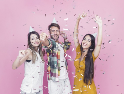 confetti-falling-friends-enjoying-against-pink-background_23-2147865340.jpg